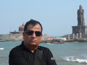 Arun at Triveni sangam,Vivekanand Rock memorial at the back.